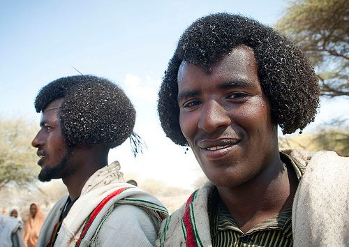 Oromo men with the pharaonic hairdress representing the head of a cobra