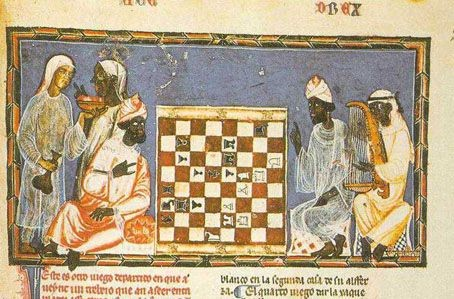 Moorish dignitaries playing chess in Spain. Beside them, two maids – a white lady and a black one – and a black musician. 1283; Source: the Golden age of the Moor, Ivan van Sertima, page 29